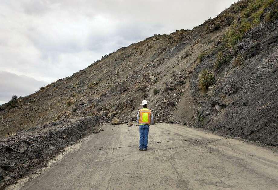 Bret Haney, construction inspector with Caltrans, looks at the south side of the Mud Creek slide south of Big Sur on May 24. Photo: Joe Johnston/The Tribune (of San Luis Obispo) Via AP / / Joe Johnston/The Tribune (of San Luis Obispo) Via AP