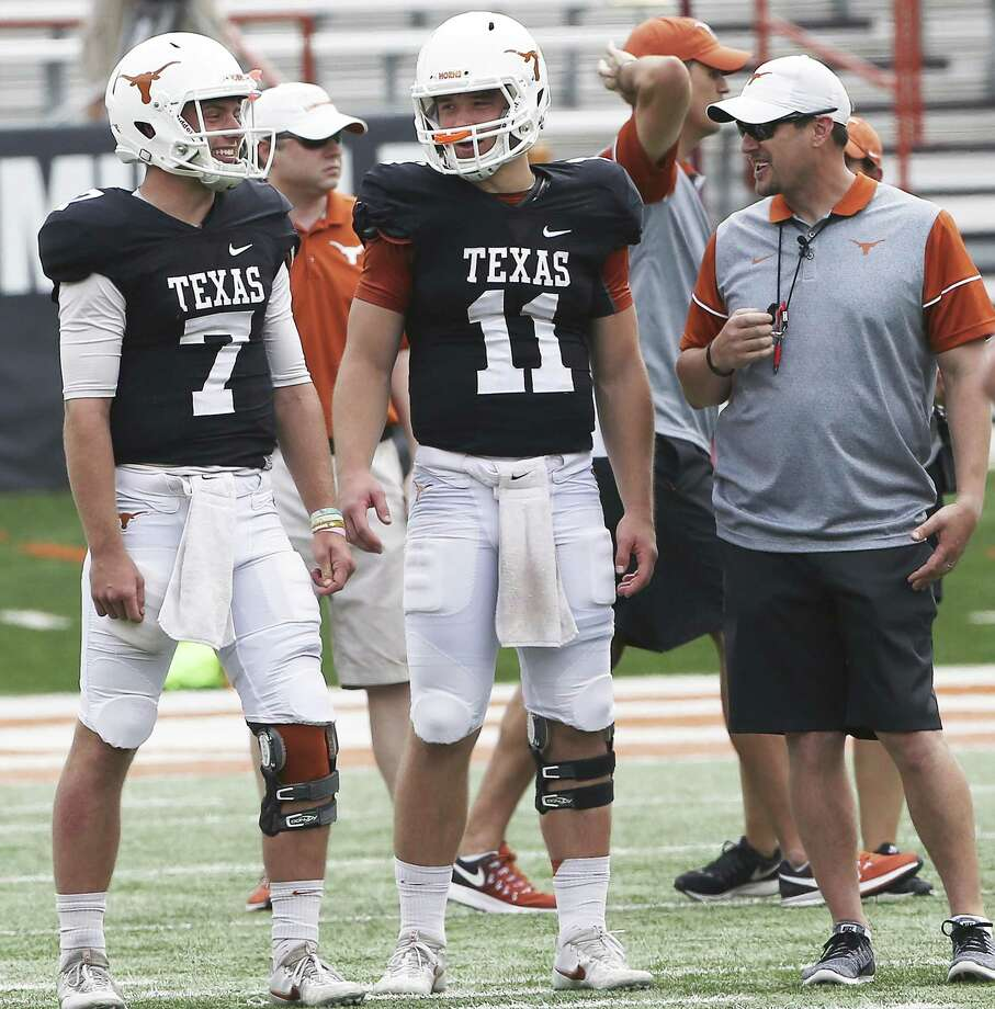 Quarterbacks Shane Buechele (7) and Sam Ehlinger (11) share a laugh with coach Tom Herman as the Texas Longhorns play their spring game on April 15, 2017. Photo: Tom Reel /San Antonio Express-News / Internal