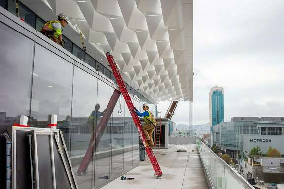 Workers continue construction of the Moscone Center South expansion on Thursday, Sept. 7, 2017, in San Francisco, Calif.