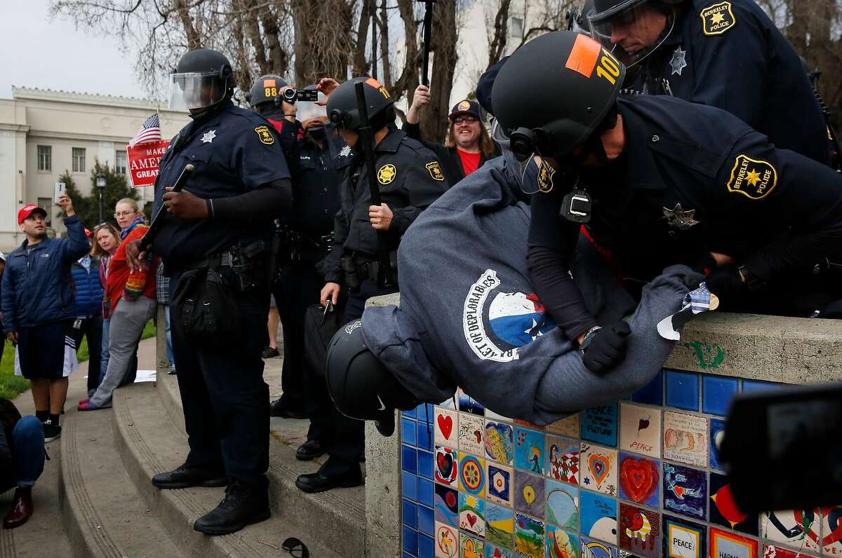 Berkeley police officers arrest a Trump supporter who allegedly had a knife on him during a pro-President Donald Trump rally and march at the Martin Luther King Jr. Civic Center park March 4, 2017 in Berkeley, Calif.
