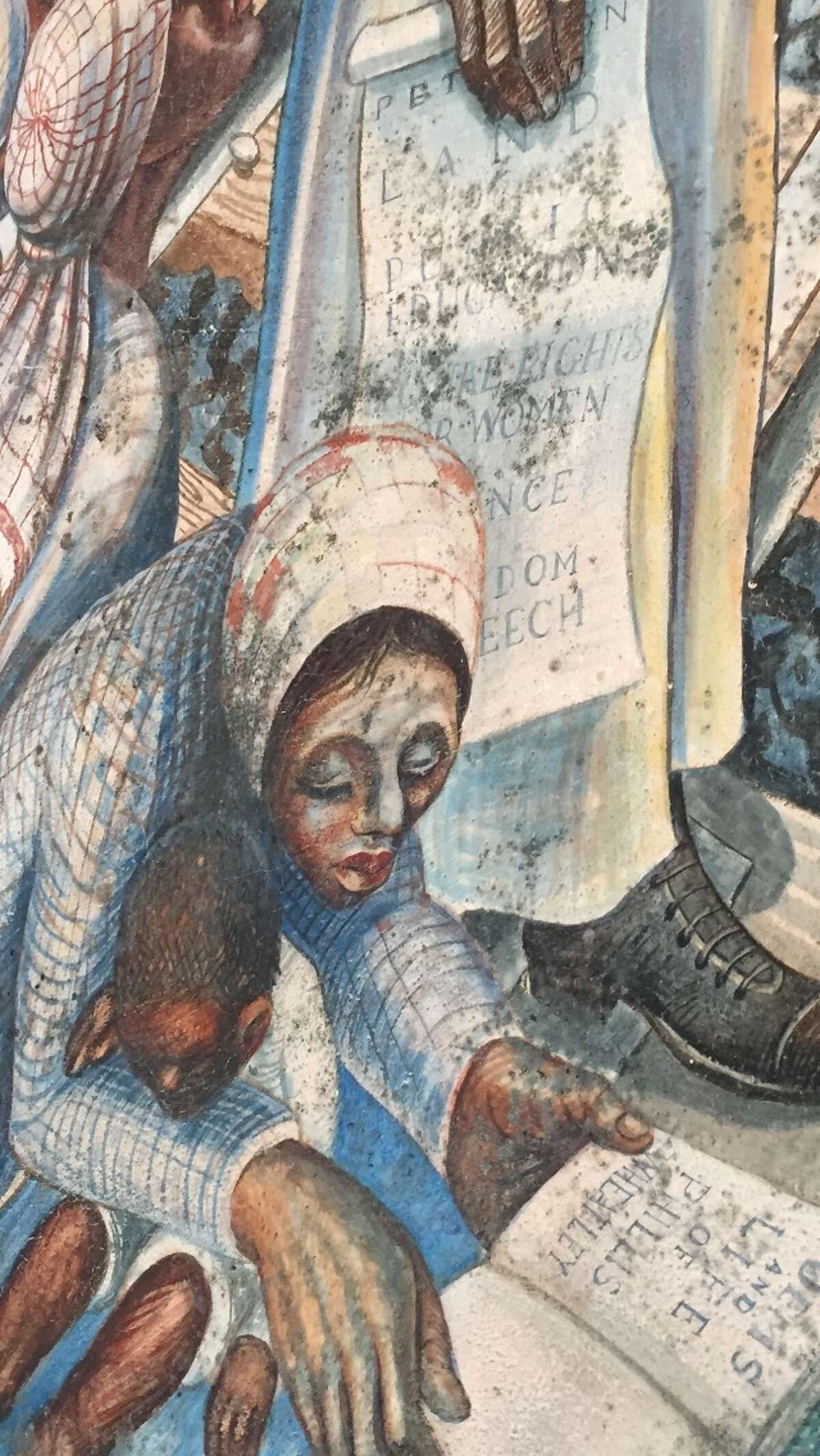 The John Biggers 1953 mural, Contribution of Negro Women to American Life and Education, covers a wall inside the Blue Triangle Multi-Cultural Association's headquarters in Houston's Third Ward. The work featuring Harriet Tubman, Sojourner Truth and Phillis Wheatley was painted when the building was operating as the Blue Triangle YWCA. A leaky roof had been threatening the mural. Caretakers pleaded in January 2016 for contributions - roughly $50,000 for a patch job and $200,000 for a complete restoration. The funding never came. In August 2017, Hurricane Harvey swept through the Houston region and sent water through the roof and walls of the historic building at 3005 McGowen. A week later, the mural has hundreds of black bursts of mold. Funders and art conservators are responding the national artistic emergency with restoration offers and money. Biggers, who founded the art department at Texas Southern University, died in 2001 at 79. He is considered one of the foremost artists who captured the black experience of the 20th century and mentored several generations of Houston artists. This photo was taken on September 8, 2017.