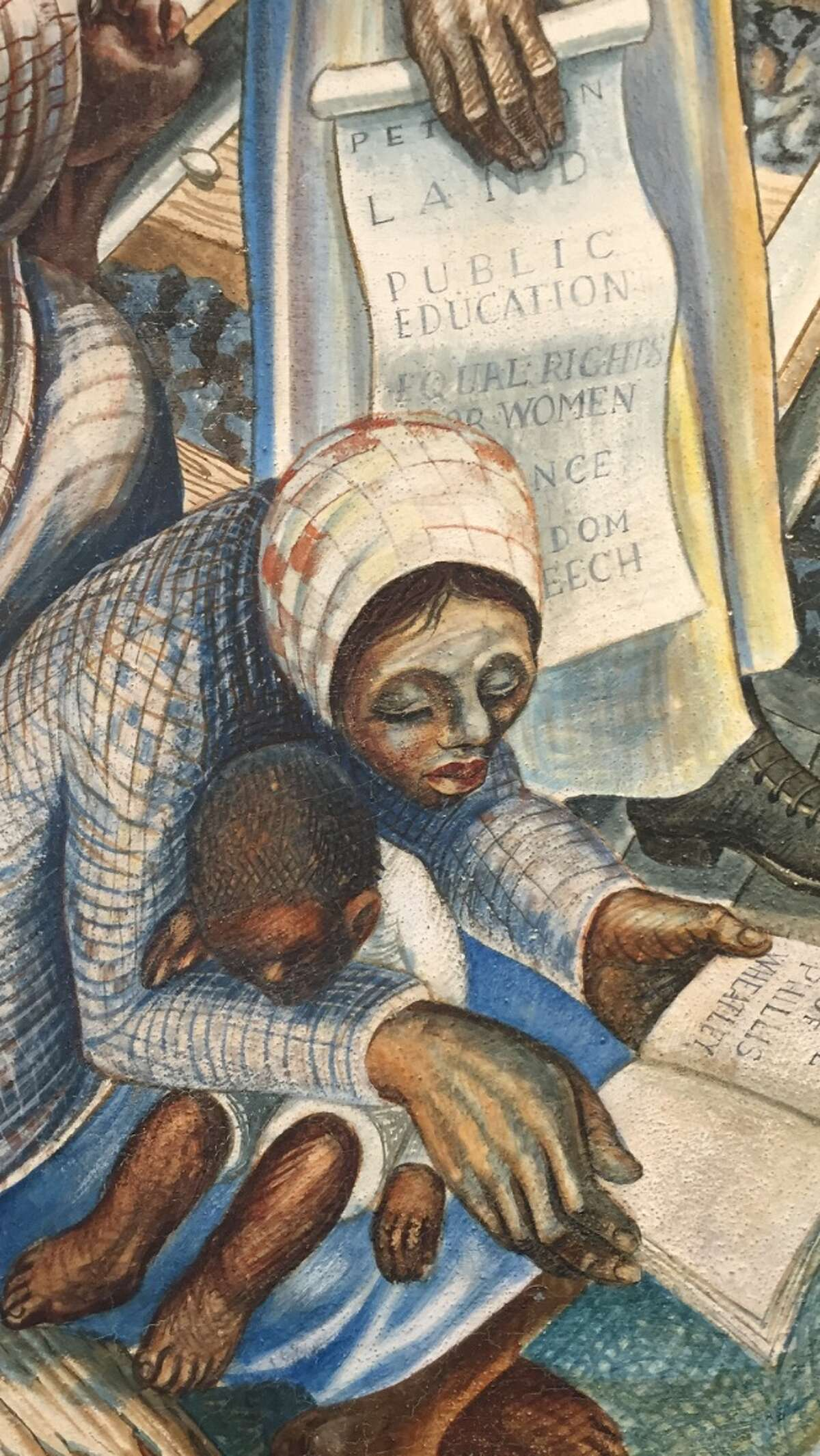 The John Biggers 1953 mural, Contribution of Negro Women to American Life and Education, covers a wall inside the Blue Triangle Multi-Cultural Association's headquarters in Houston's Third Ward. The work featuring Harriet Tubman, Sojourner Truth and Phillis Wheatley was painted when the building was operating as the Blue Triangle YWCA. A leaky roof had been threatening the mural. Caretakers pleaded in January 2016 for contributions - roughly $50,000 for a patch job and $200,000 for a complete restoration. The funding never came. In August 2017, Hurricane Harvey swept through the Houston region and sent water through the roof and walls of the historic building at 3005 McGowen. A week later, the mural has hundreds of black bursts of mold. Funders and art conservators are responding the national artistic emergency with restoration offers and money. Biggers, who founded the art department at Texas Southern University, died in 2001 at 79. He is considered one of the foremost artists who captured the black experience of the 20th century and mentored several generations of Houston artists. This is a snapshot of the mural from January 2016 before the damage.