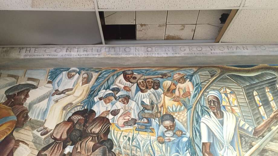 The John Biggers 1953 mural, Contribution of Negro Women to American Life and Education, covers a wall inside the Blue Triangle Multi-Cultural Association's headquarters. Photo: Cindy George   Houston Chronicle