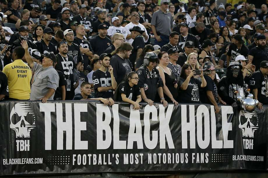 Oakland Raiders fans watch from the Black Hole section of the Oakland Coliseum. Photo: Eric Risberg, Associated Press