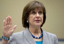 In this May 22, 2013 file photo, IRS official Lois Lerner is sworn in on Capitol Hill in Washington before the House Oversight Committee. The Department of Justice has once again decided not to charge Lerner in the IRS� mistreatment of conservative political groups during the 2010 and 2012 elections.  (AP Photo/Carolyn Kaster)