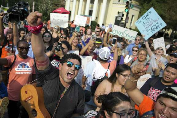 Protesters demonstrate in support of recipients of the Deferred Action for Childhood Arrivals program, in Washington, Sept. 5, 2017. The rollback of the DACA program could disrupt many other aspects of immigrants lives, like health care, financial aid and drivers licenses.