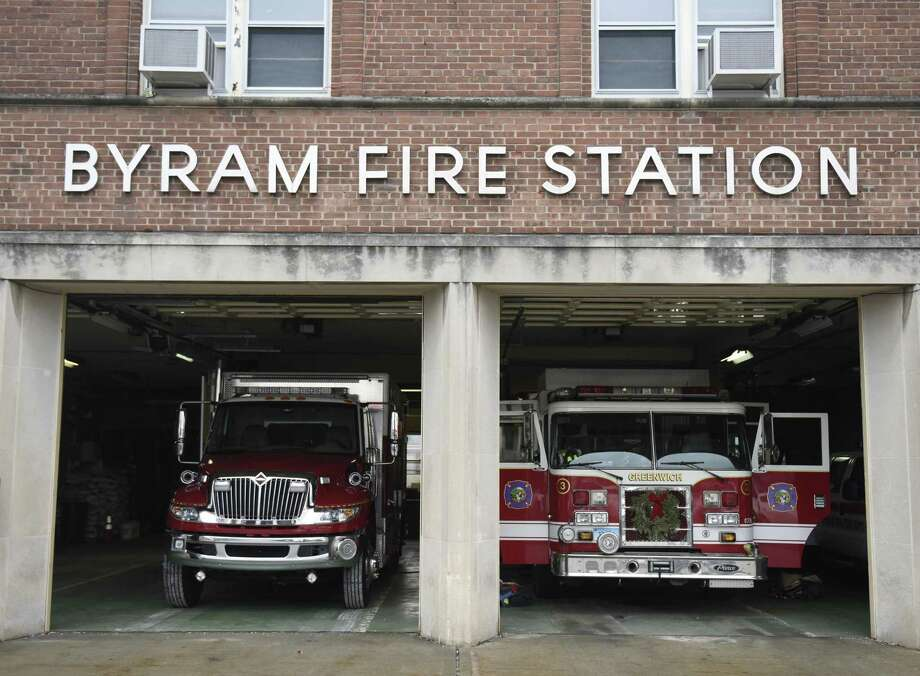 Fire trucks are parked inside the Byram Volunteer Fire Department in the Byram section of Greenwich, Conn. Thursday, Jan. 12, 2017. Photo: Tyler Sizemore / Hearst Connecticut Media / Greenwich Time