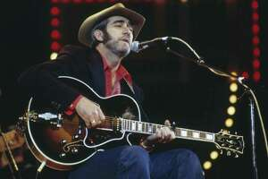FILE - SEPTEMBER 08: Country singer Don Williams has died at 78 years old. Don Williams, U.S. country music singer-songwriter, playing the guitar and singing into a microphone on stage at the Country Music Festival, at Wembley Arena, London, England, Great Britain, in April 1982. (Photo by David Redfern/Redferns/Getty Images)