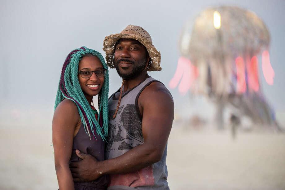 A couple wearing their fashion at Burning Man 2017. Photo: Sidney Erthal / Burning Man