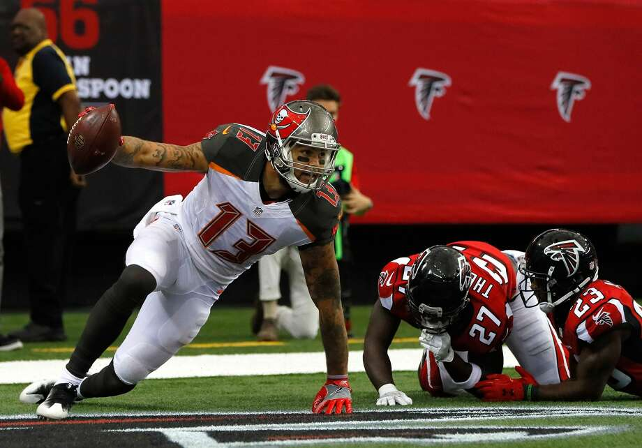 ATLANTA, GA - SEPTEMBER 11:  Mike Evans #13 of the Tampa Bay Buccaneers reacts after pulling in this touchdown reception against Robert Alford #23 of the Atlanta Falcons at Georgia Dome on September 11, 2016 in Atlanta, Georgia.  (Photo by Kevin C. Cox/Getty Images) Photo: Kevin C. Cox/Getty Images