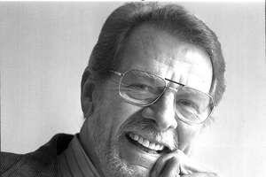 Chronicle Business writer Lloyd Watson retires 1993   Staff photo