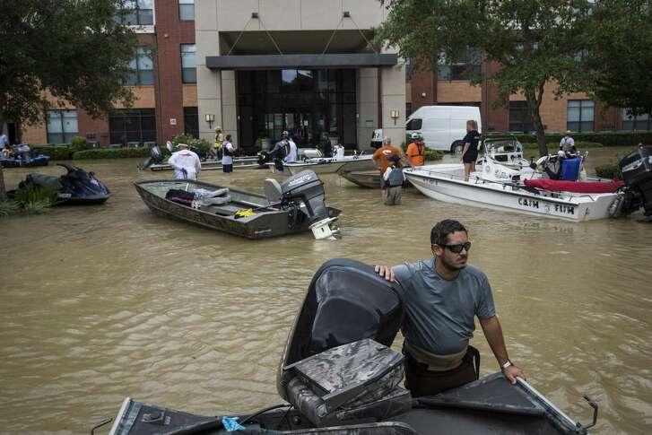 Kenny Young, a civilian rescue boat operator, surveys the scene outside the Broadstone Memorial apartment complex in Houston on Aug. 30. One lesson is that we need to stop building where floods are certain to occur.