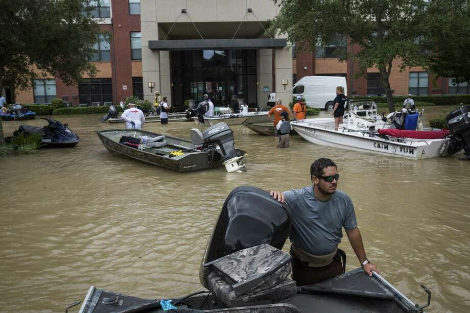 Kenny Young, a civilian rescue boat operator, surveys the scene outside the Broadstone Memorial apartment complex in Houston on Aug. 30. One lesson is that we need to stop building where floods are certain to occur. Photo: ANDREW BURTON /NYT / NYTNS