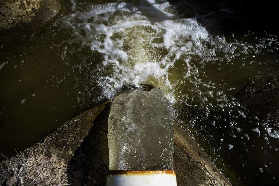 Yes, groundwater in Texas in private property, but that doesn't mean it still isn't subject to regulation. Here, pumped groundwater pours into an irrigation ditch in 2015 on the farm of Bobby Skov, a farmer in Fabens. Photo: MAX WHITTAKER /New York Times / NYTNS