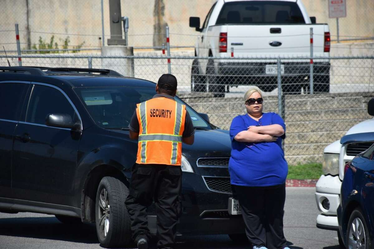 Patience and fuel conservation are vital after a natural disaster. Here, a woman in San Antonio prevents a driver from cutting into a gas line after Hurricane Harvey. Panic caused a run on gas.