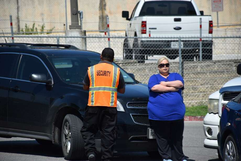 Patience and fuel conservation are vital after a natural disaster. Here, a woman in San Antonio prevents a driver from cutting into a gas line after Hurricane Harvey. Panic caused a run on gas. Photo: File Photo / San Antonio Express-News