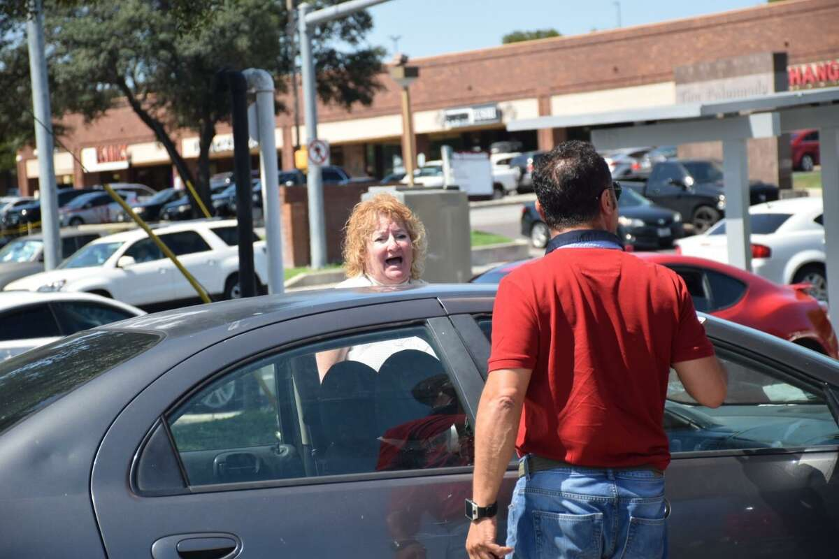 A woman yells at another customer waiting in line for gas on Thursday, August 31, 2017. Lines for gas grew long in San Antonio as fuel ran short after Hurricane Harvey shut down multiple Gulf Coast refineries.