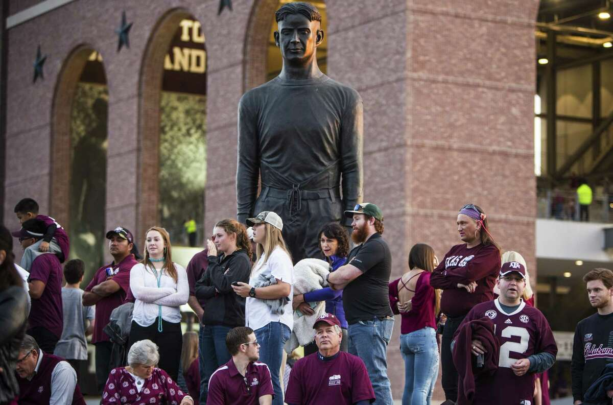 Texas A&M fans watch theCorps of Cadets march to Kyle Field before a game against LSU on Nov. 24, 2016, in College Station.