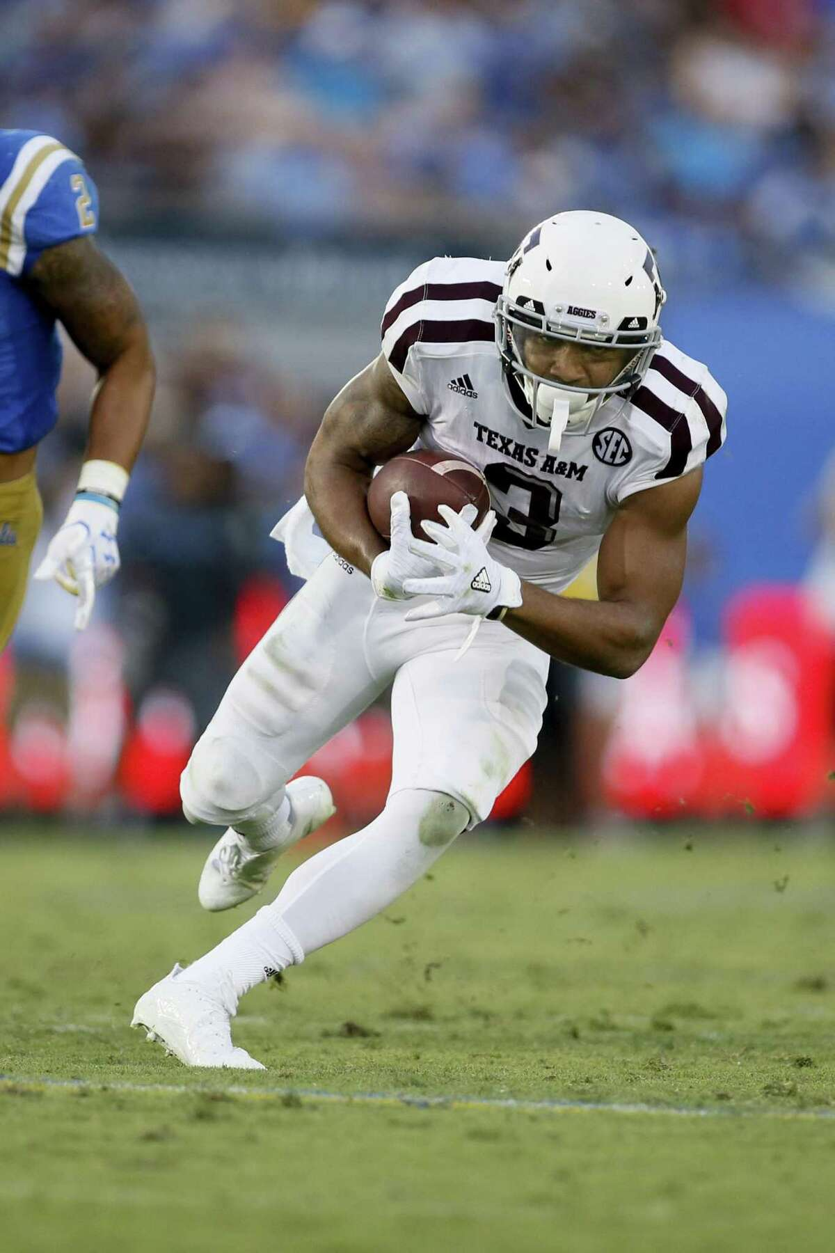 Texas A&M wide receiver Christian Kirk runs after a catch against UCLA on Sept. 3, 2017, in Pasadena, Calif.