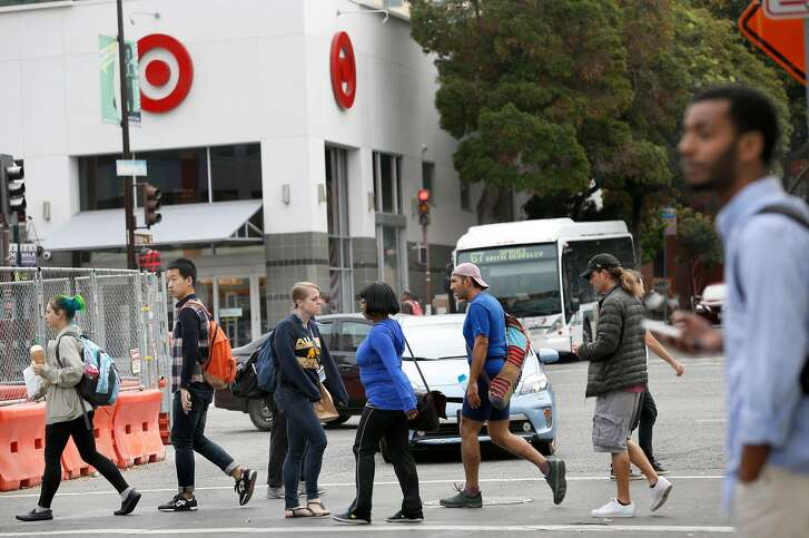 Pedestrians cross Shattuck Ave. near Target on Friday, September 8, 2017, in Berkeley, Calif.   The most valuable piece of real estate for retailers  today isn�t malls but college campuses.