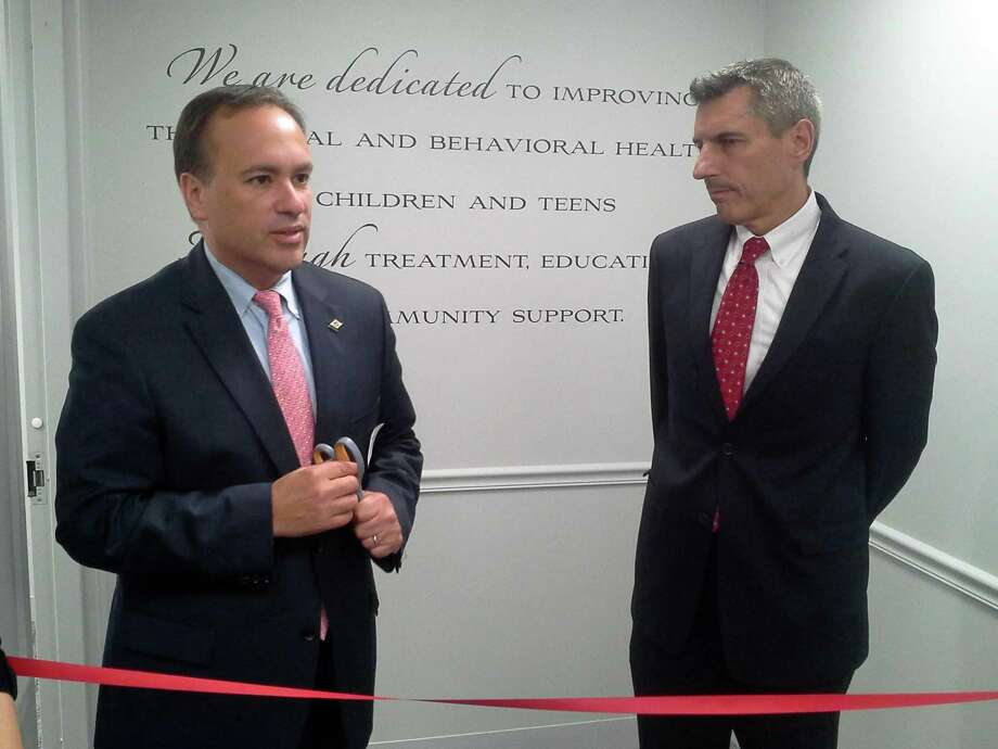 Greenwich First Selectman Peter Tesei, left, and Child Guidance Center of Southern Connecticut, Inc., President and CEO Eliot Brenner cut the ribbon Friday morning for the agency's new, expanded offices at Holly Hill Lane. Photo: Ken Borsuk