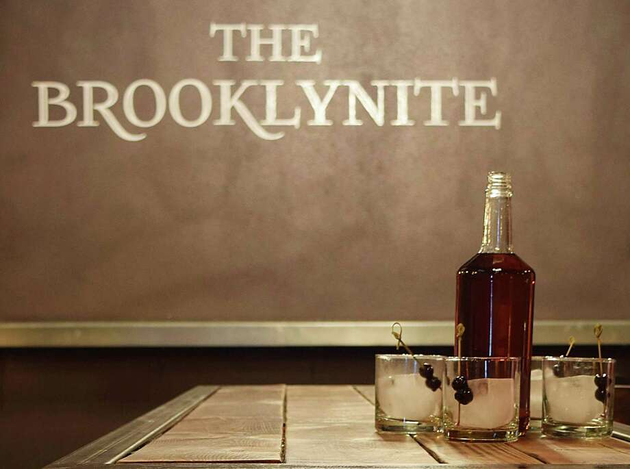 The Brooklynite bar in San Antonio has started offering bottle service version of classic cocktails like the old fashioned (pictured) and Manhattans served with rocks glasses, large-format ice and garnishes of orange peel and cherries. Photo: Carrie Hoffman /Courtesy Of The Brooklynite