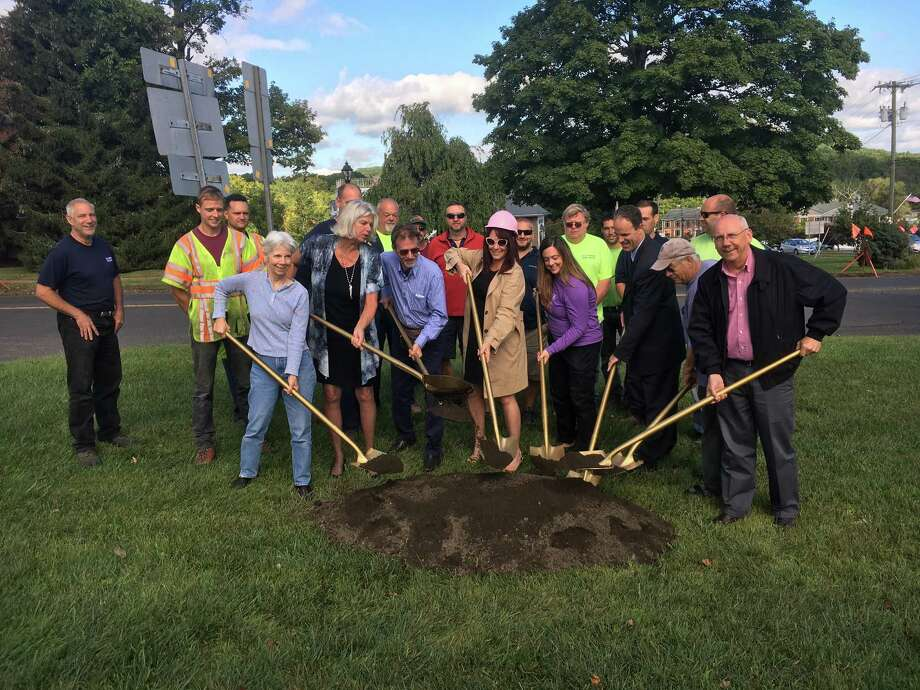First Selectman Susan Chapman, joined by town officials, state Department of Transportation officials and business owners, breaks ground for the sidewalk project in New Fairfield. Photo: Anna Quinn /Hearst Connecticut Media