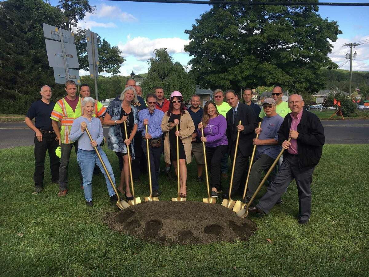 First Selectman Susan Chapman, joined by town officials, state Department of Transportation officials and business owners, breaks ground for the sidewalk project in New Fairfield.