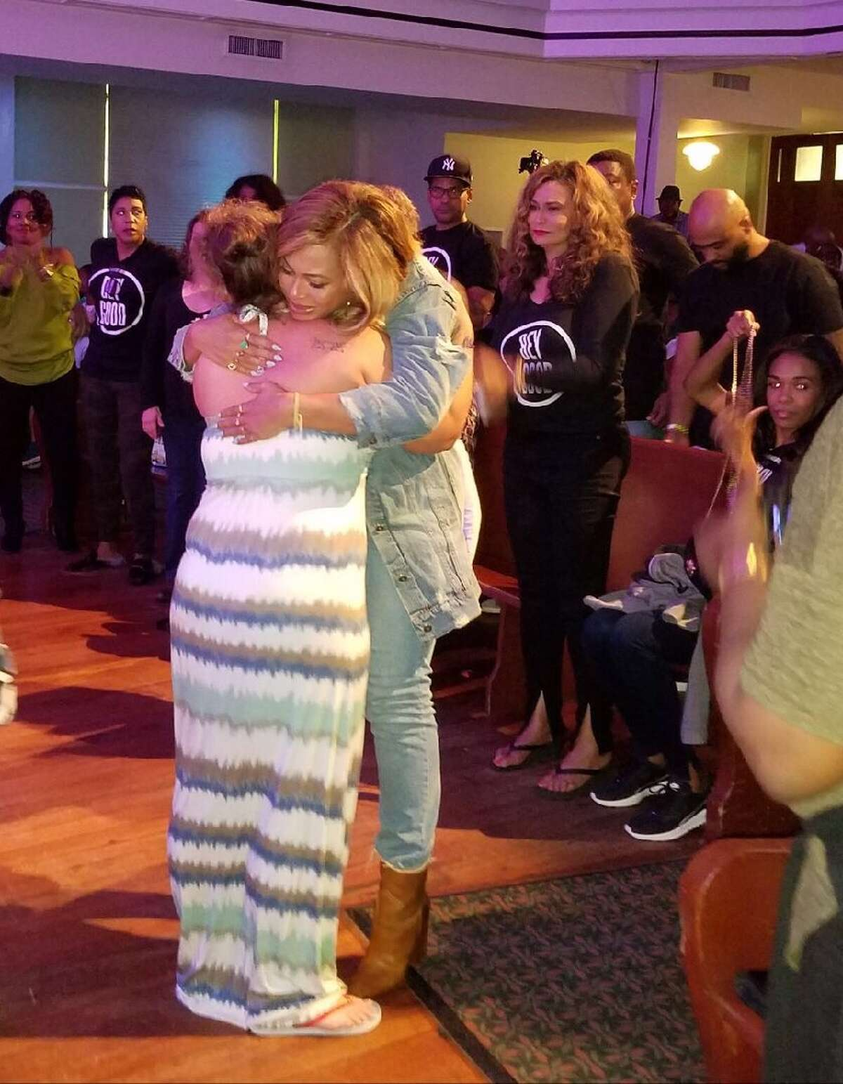 Beyonce hugs an evacuee at St. John's in downtown Houston.