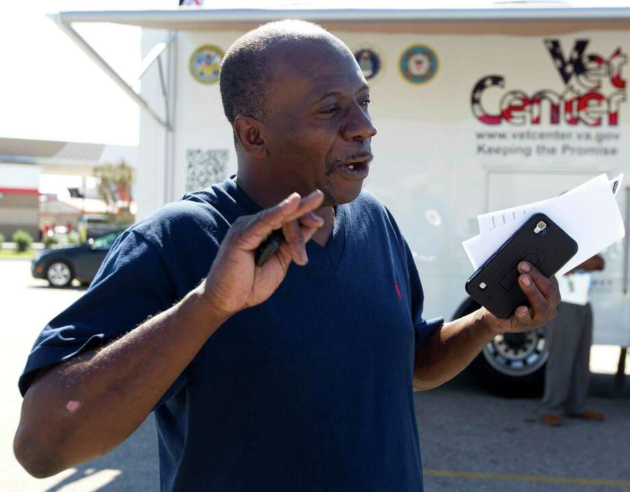 Army veteran Milton Emerson talks about information on various medical and counseling services from the Veterans Affairs' Mobile Vet Center, Thursday, Sept. 7, 2017, in Porter. The mobile center is one of six service center in Houston to help veterans in communities affect by Hurricane Harvey. Photo: Jason Fochtman, Staff Photographer / © 2017 Houston Chronicle