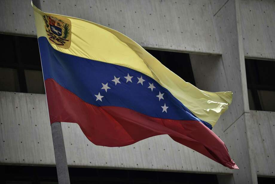 The Venezuelan flag flies outside the Supreme Court in Caracas, Venezuela on Aug. 1. The current Venezuelan political upheaval underscores the wisdom of separation of powers in U.S. government. Photo: Carlos Becerra /Bloomberg / © 2017 Bloomberg Finance LP