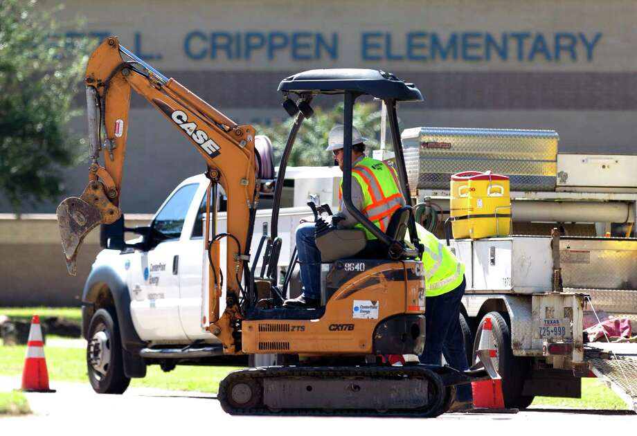 CenterPoint Energy employees work to control a gas leak at Robert Crippen Elementary, Friday, Sept. 8, 2017, in Porter. Photo: Jason Fochtman, Staff Photographer / © 2017 Houston Chronicle