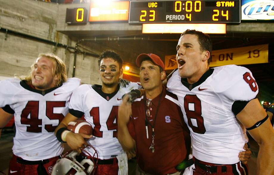 Stanford's Ben Ladner, Tavita Pritchard, coach Jim Harbaugh, and Evan Moore, from left, celebrate after Stanford upset Southern California 24-23 in a football game in Los Angeles on Saturday, Oct. 6, 2007. (AP Photo/Matt Sayles) Photo: Matt Sayles, AP