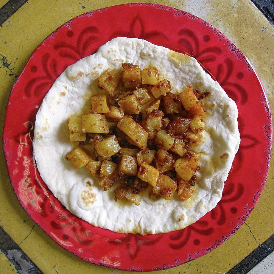 Chorizo and potato taco on a handmade flour tortilla from Elena's Cafe. Photo: Mike Sutter /San Antonio Express-News