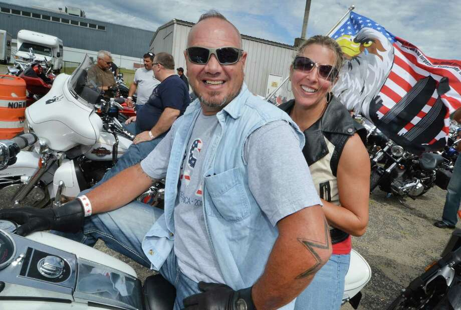 Norwalk's Dan Mariano and wife Heidi get seated for their 5th United Ride at Norden Park as thousands of motorcyclists ride in the CT United Ride, Connecticut's largest 9/11 tribute — a 60 mile motorcade through Faifield County starting at Norden Park in Norwalk Conn. on Sunday September 11, 2016 and ending at Seaside Park in Bridgeport Photo: Alex Von Kleydorff / Hearst Connecticut Media / Connecticut Post