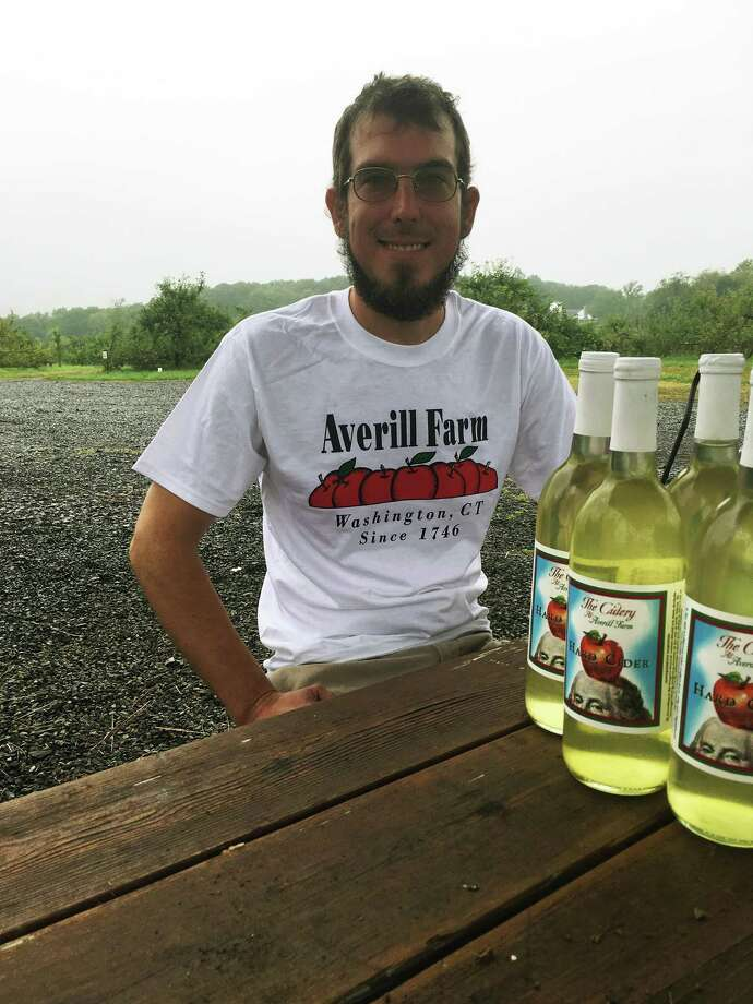 Tyson Averill is the 10th generation of his family to work at his family's farm and orchard in Washington, Conn. Several years ago, they introduced hard cider and apple wine to their lineup. Photo: Christina Hennessy / Hearst Connecticut Media / Connecticut Post