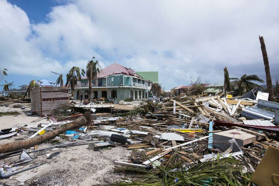TOPSHOT - A photo taken on September 7, 2017 shows damage in Orient Bay on the French Carribean island of Saint-Martin, after the passage of Hurricane Irma. France, the Netherlands and Britain on September 7 rushed to provide water, emergency rations and rescue teams to territories in the Caribbean hit by Hurricane Irma, with aid efforts complicated by damage to local airports and harbours. The worst-affected island so far is Saint Martin, which is divided between the Netherlands and France, where French Prime Minister Edouard Philippe confirmed four people were killed and 50 more injured.    / AFP PHOTO / Lionel CHAMOISEAULIONEL CHAMOISEAU/AFP/Getty Images Photo: LIONEL CHAMOISEAU / AFP/Getty Images / AFP or licensors