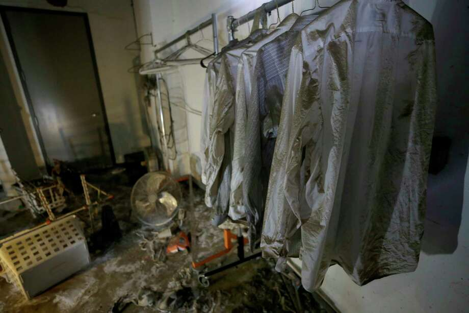 Many storm victims have no way to clean their clothes, so Tide is offering to help. These flood-damaged shirts were hanging in the prop room at the Alley Theatre. Photo: Melissa Phillip, Staff / © 2017 Houston Chronicle
