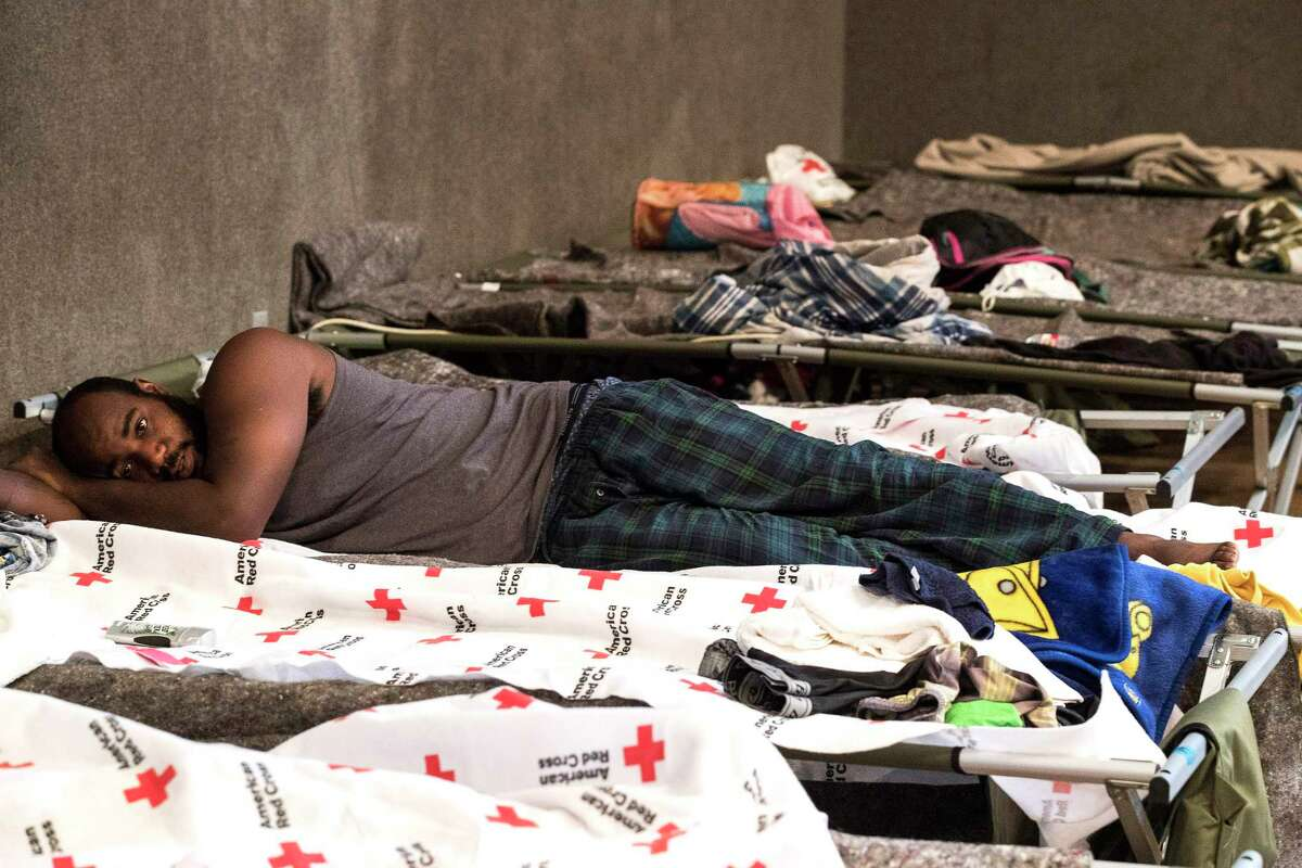 Larry Jones, of Kendelton, lies on a cot in a Red Cross Shelter at the Sacred Heart Church, following his evacuation from Tropical Storm Harvey, on Sunday, Aug. 27, 2017, in Richmond. ( Brett Coomer / Houston Chronicle )
