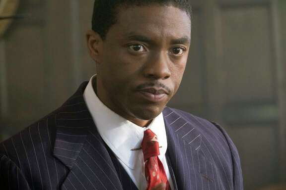 "Chadwick Boseman portrays Thurgood Marshall before he became a justice of the Supreme Court in ""Marshall."""