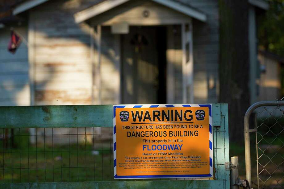 A FEMA warning sign at a home damaged by floodwaters in Patton Village.