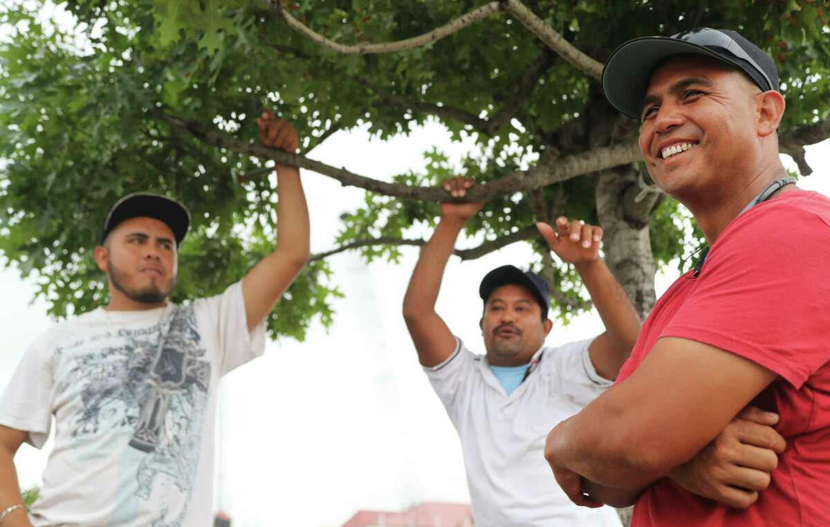 Day laborers at Home Depot, Pedro Galan, left, 20, an U.S. citizen, Orlando Rodas, center, 36, an undocumented immigrant and Fabian Mendoza, right, 42, a green card holder, talk about Texas law, known as Senate Bill 4 on the parking of Home Depot, Tuesday, Aug. 8, 2017, in Houston. ( Marie D. De Jesus / Houston Chronicle )
