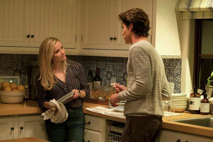 """Reese Witherspoon plays a successful, newly single mom with younger potential love interests, including one played by Pico Alexander, in """"Home Again."""""""