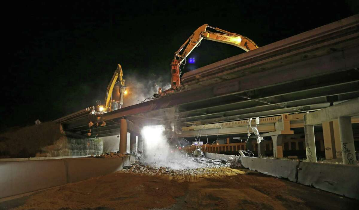 The demolition of old bridges will shut down Interstate 35 and Interstate 10 this weekend. The projects are similar to this job last April on I-35 near NE Loop 410 on the Northeast Side. The new bridge is in the background.