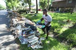 "Sharpstown High School football running-back Michael Morris aids in the clean up efforts in the neighborhood of high school Thursday, Sept. 7, 2017, in Houston. Sharpstown High School organized the ""Sharpstown HS Cares Harvey Restoration and Clean Up Event"" for which faculty, students, and community members assisted in the cleanup efforts. ( Steve Gonzales / Houston Chronicle )"