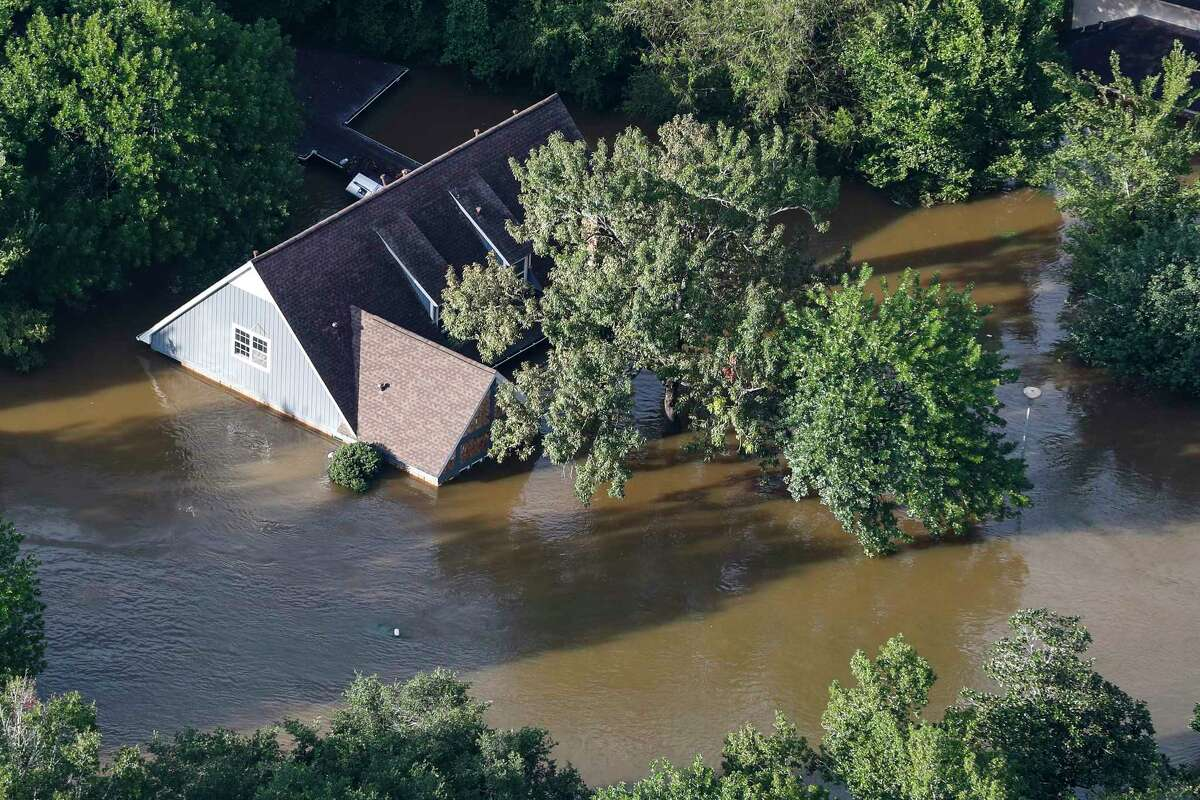 A neighborhood flooded by rains from Tropical Storm Harvey is shown under water on Tuesday, Aug. 29, 2017, in Houston. ( Brett Coomer / Houston Chronicle )