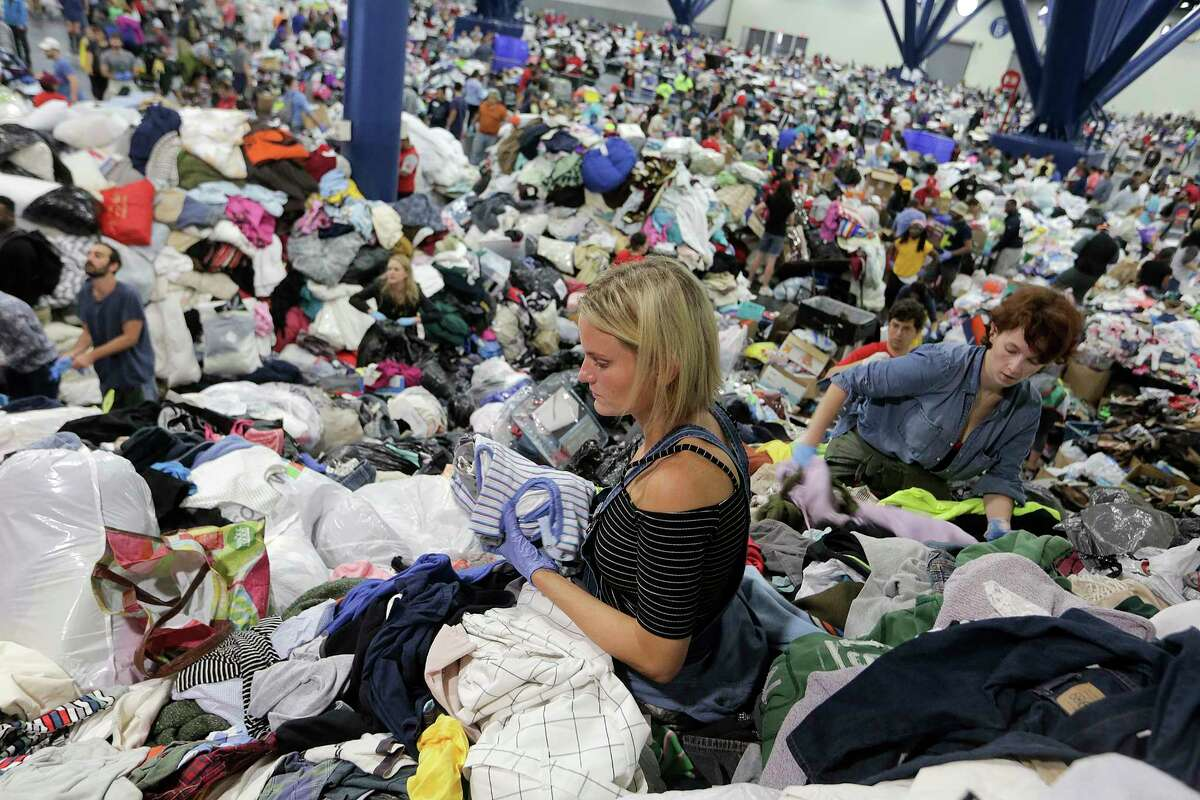 Kathryn Loder sorts donated clothing at George R. Brown Convention Center in Houston as Tropical Storm Harvey inches its way through the area on Tuesday, Aug. 29, 2017. ( Elizabeth Conley / Houston Chronicle )