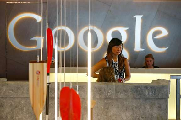 FILE -- Employees in Google's offices at Kendall Square in Cambridge, Mass., Aug. 5, 2014. Female employees are paid less than male staff at most job levels within Google and the pay disparity doubles as women climb the corporate ladder, according to a 2017 spreadsheet compiled by employees. (Jared Wickerham/The New York Times)