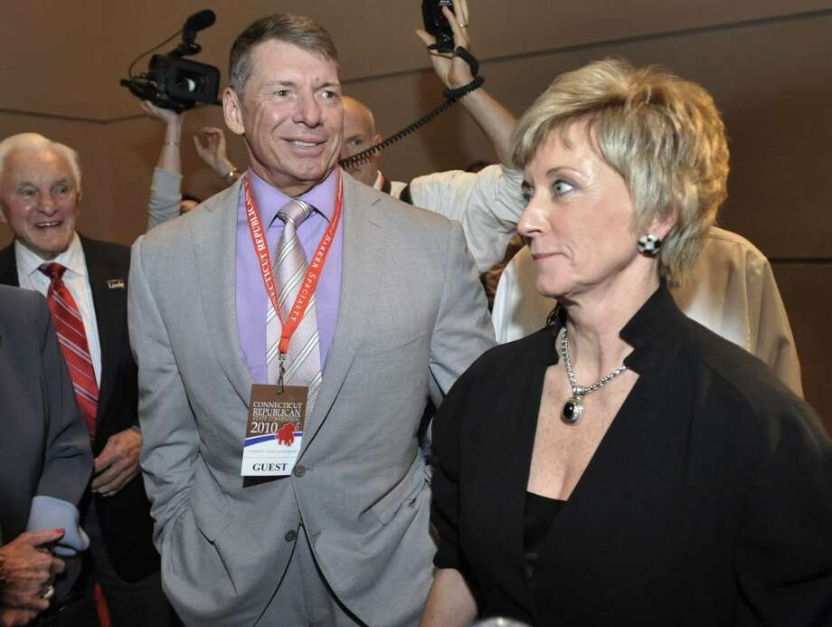 FILE - In this May 21, 2010 file photo, Republican candidate for U.S. Senate Linda McMahon, right, and husband Vince McMahon, left, wait for delegate totals to be tallied during the Republican nomination at the Connecticut Republican Convention in Hartford, Conn. The widow of a World Wrestling Entertainment performer who died in a 1999 stunt says she's suing the Connecticut-based company and its leaders, including Republican U.S. Senate candidate Linda McMahon. Martha Hart, widow of Owen Hart, plans to file her lawsuit Tuesday, June 22, 2010, in U.S. District Court in Hartford. (AP Photo/Jessica Hill, File) Photo: Jessica Hill, AP / AP2010