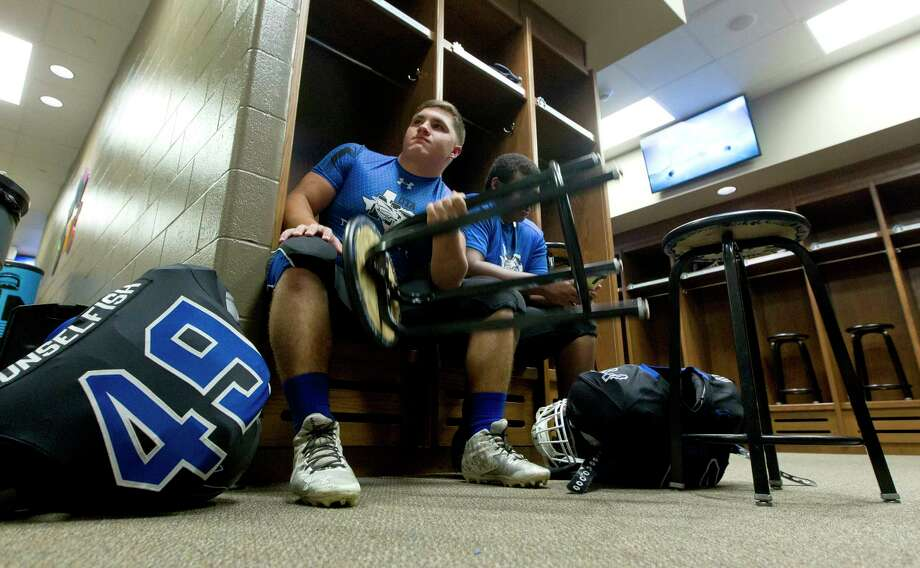New Caney running back Austin Fralick (49) does curls with a chair before a non-district high school football game against Tomball Memorial at Texan Drive Stadium, Friday, Sept. 8, 2017, in New Caney. Photo: Jason Fochtman, Houston Chronicle / © 2017 Houston Chronicle